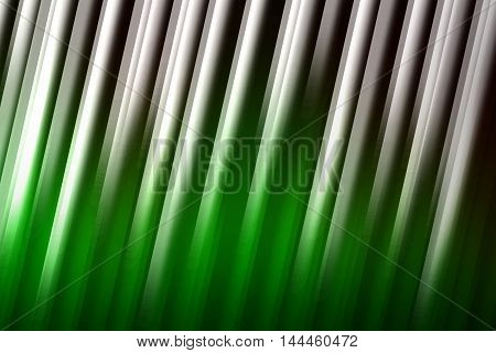 Green and black with rays of light blend to create abstract background