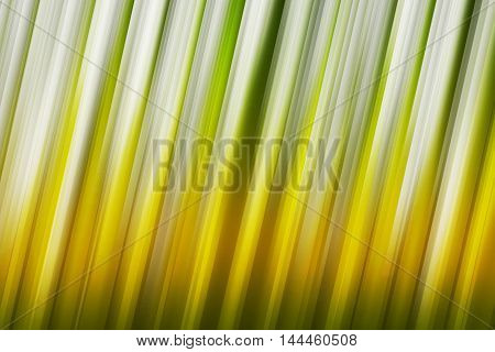 Green, yellow, and orange rays of light blend to create abstract background