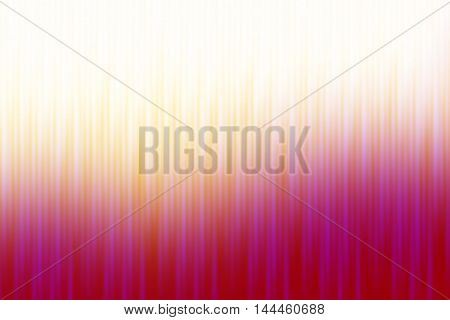 Red pink and orange blurred rays of light blend to create abstract background