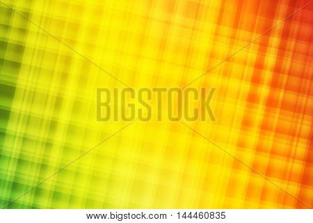 Green yellow orange and red blend to create abstract background