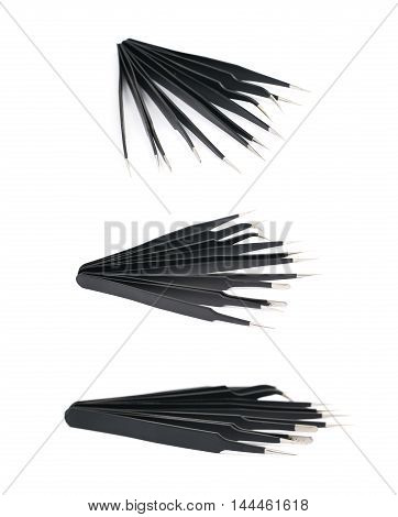 Pile of black metal anti-static tweezers tools isolated over the white background, set of three different foreshortenings