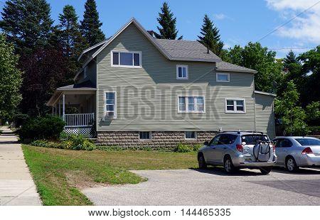 PETOSKEY, MICHIGAN / UNITED STATES - AUGUST 5, 2016: A two story home near downtown Petoskey, Michigan.