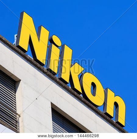 Basel, Switzerland - 27 August, 2016: Nikon promotion on the top of a building on Centralbahnlatz square. Nikon Corporation, also known just as Nikon, is a Japanese multinational corporation specializing in optics and imaging products.