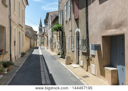 Typical houses in a narrow street in city center of Saint-Saturnin-les-Apt a small village in French Provence