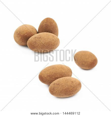 Few chocolate coated almond nuts isolated over the white background, set of two different foreshortenings