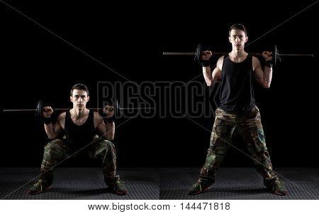 Back squat exercise. Studio shot over black.