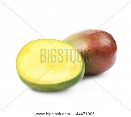 Sliced and cut ripe mango fruit composition isolated over the white background