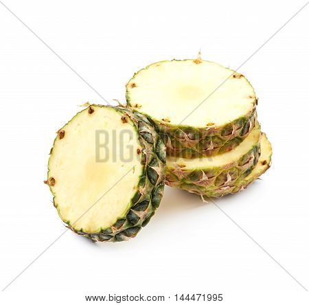 Pile of cross-section pineapple fruit slices isolated over the white background