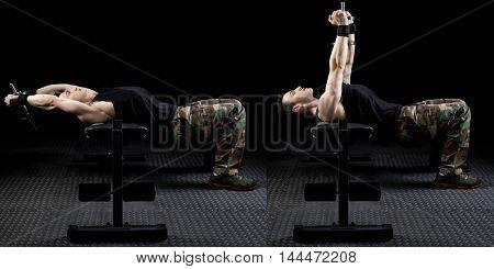 Dumbbell pull over exercise. Studio shot over black.
