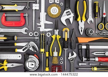 Tool Set Of Pliers, Wrenches, Hammer, Clamps, Screwdrivers On Grey Background