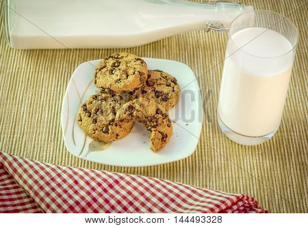 Swett snack, cookies and milk - Food photography with a couple of delicious cookies on a plate and a glass of milk on the side