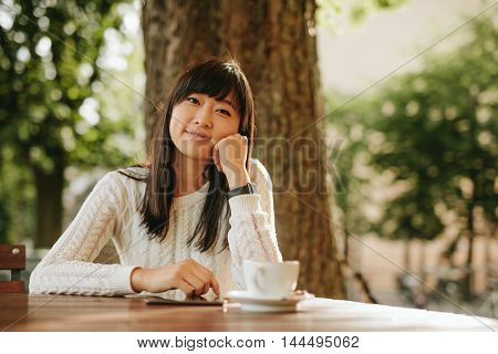 Happy Chinese Woman At Cafe Table With Digital Tablet