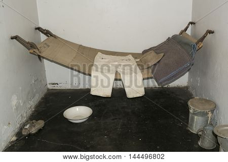Adelaide, South Australia, Australia - August 14 2016: Typical provisions and clothing warn by prisoners and displayed in a remand cell at the old historic Adelaide Gaol.