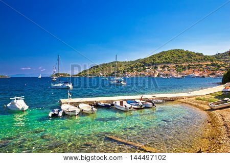 Turquoise beach and small harbor on Vis island Dalmatia Croatia