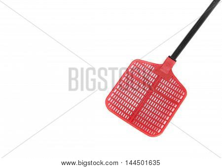 Red fly swatter. Single flyswatter with reflections. Object made of plastic very efficient and unfailing tool in catching flies.