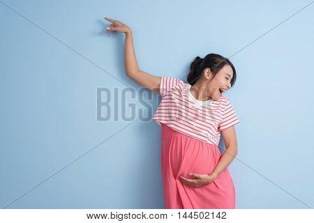happy dancing pregnant woman, closeup portrait