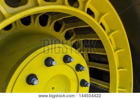A closeup of a tractor track wheel.