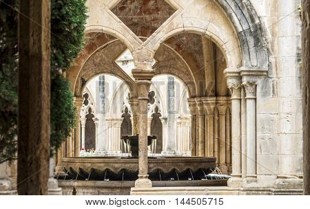 Detail of the cloister of Santa Maria de Poblet Monastery, Unesco heritage. Romanesque cloister architecture in Poblet, Spain.