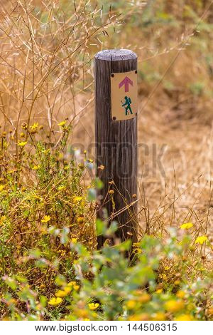 touristic pointer is sign on a wooden post