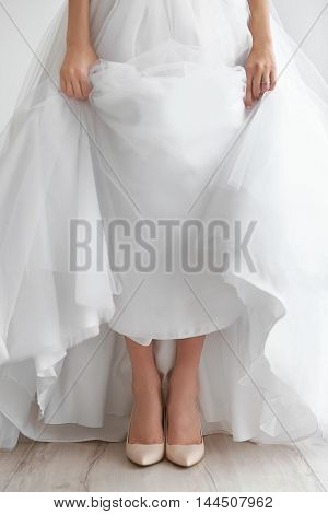 Bride in a beautiful wedding gown and shoes