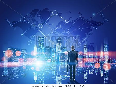 Businessman in suit standing near big city panorama with map in sky. Concept of international trading. Toned image. Double exposure