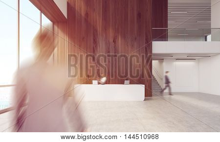 People in company's lobby. Reception desk with computers. Businessman going to workplace. Concept of busy office. 3d rendering. Mock up. Toned image