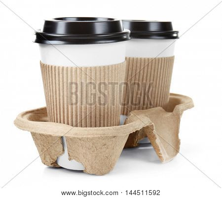 Cups of coffee in holder, isolated on white