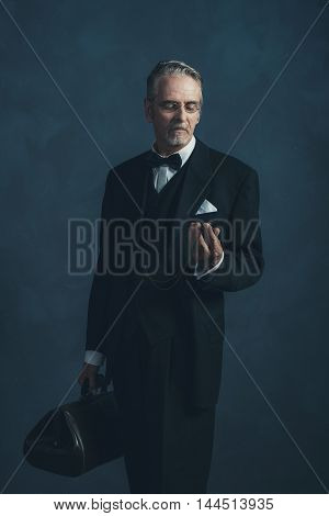 Vintage 1920S Doctor Looking At Pocket Watch.