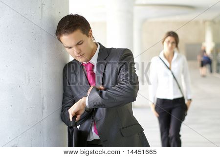 Businesspeople (he is waiting and she is late)