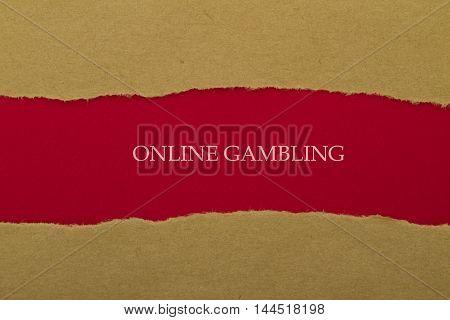 Online Gambling written under torn paper .