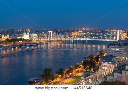 Erzsebet (Elisabeth) Bridge across Danube and Budapest panorama at dusk