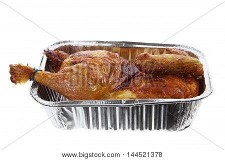 Whole Roast Chicken in Foil Tray on White Background
