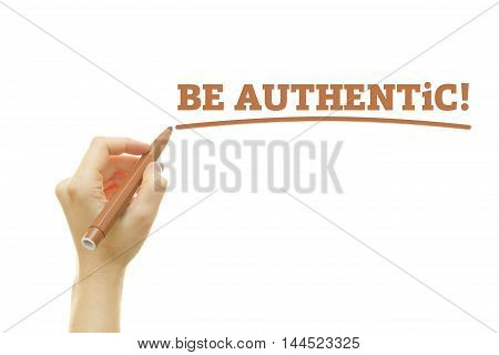 Hand writing Be Authentic on a transparent wipe board.