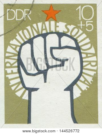 171e GERMANY - CIRCA 1972: A stamp printed in East Germany, showing of International Solidarity of Communists, circa 1972