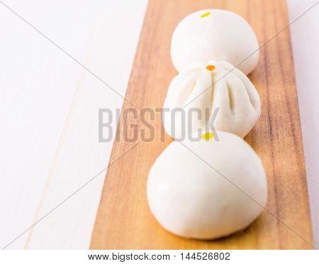 Fresh Chinese Bun dimsum on wooden tray
