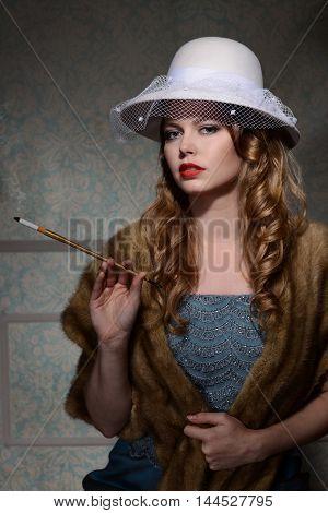 portrait of 1940s fashion woman with cigarette