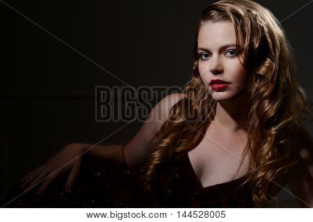 sexy brunette woman 1940s glamour portrait with black background