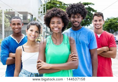 Group of relaxed mixed young adults in city in the summer