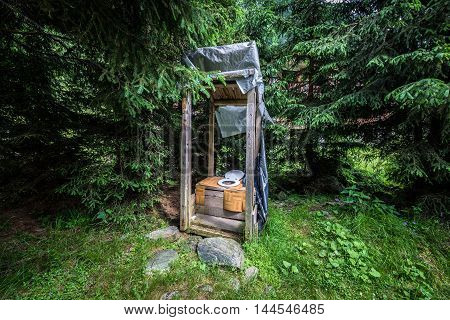 outhouse next to Transfagarasan Road in southern section of Carpathian Mountains in Romania