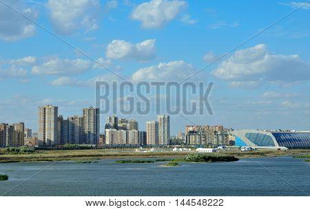Kazan, Tatarstan, Russia - August 28, 2016. Kazan, Tatarstan, Russia - August 28, 2016. View New Savinovskij district of Kazan. Kazanka River. Palace of Water Sports.