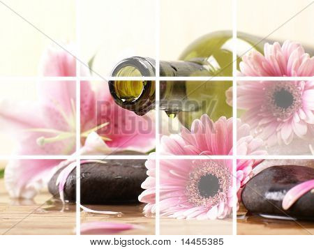 Bottle of massaging oil over spa background