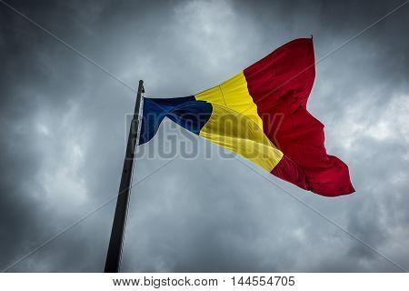 Romanian national flag in Citadel of Alba Iulia city in Romania poster
