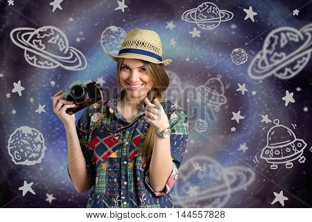 young photographer with sketch galaxy in bacgraund
