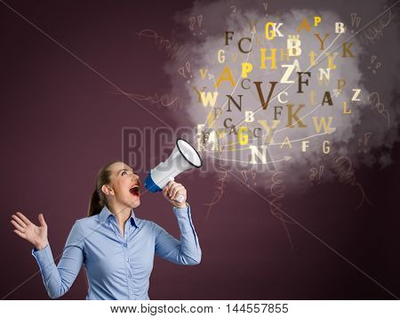 Young business woman screaming into a megaphone