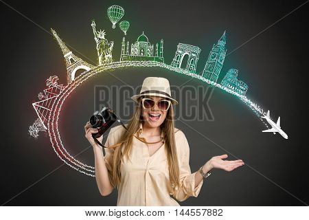 Excited Tourist with photo camera and  landmarks from different cities