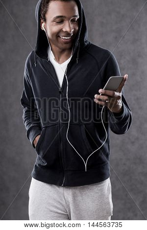 African American Man Standing And Looking At Phone Screen