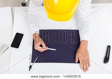 Engineer In Yellow Helmet Drawing Blueprint