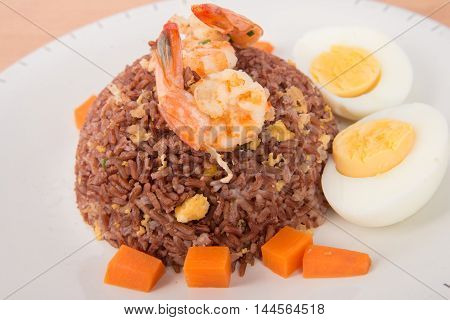 Fired brown rice with shrimp, carrot  and boiled egg healthy clean food none oil added low fat