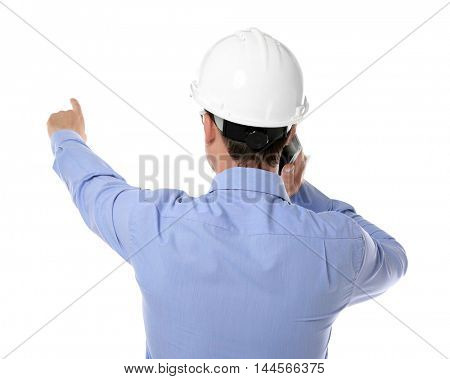 Construction worker with cellphone, isolated on white