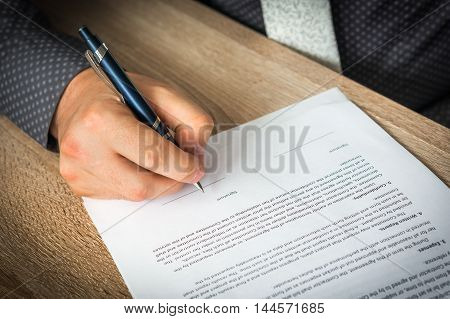 Businessman Is Signing A Contract To Conclude A Deal